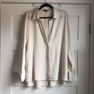 Cream colored long sleeve blouse
